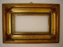 Antique gilded frame, with ornaments, made about 1830/40.